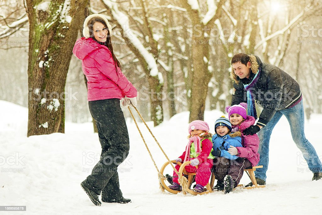Family in a winter park stock photo