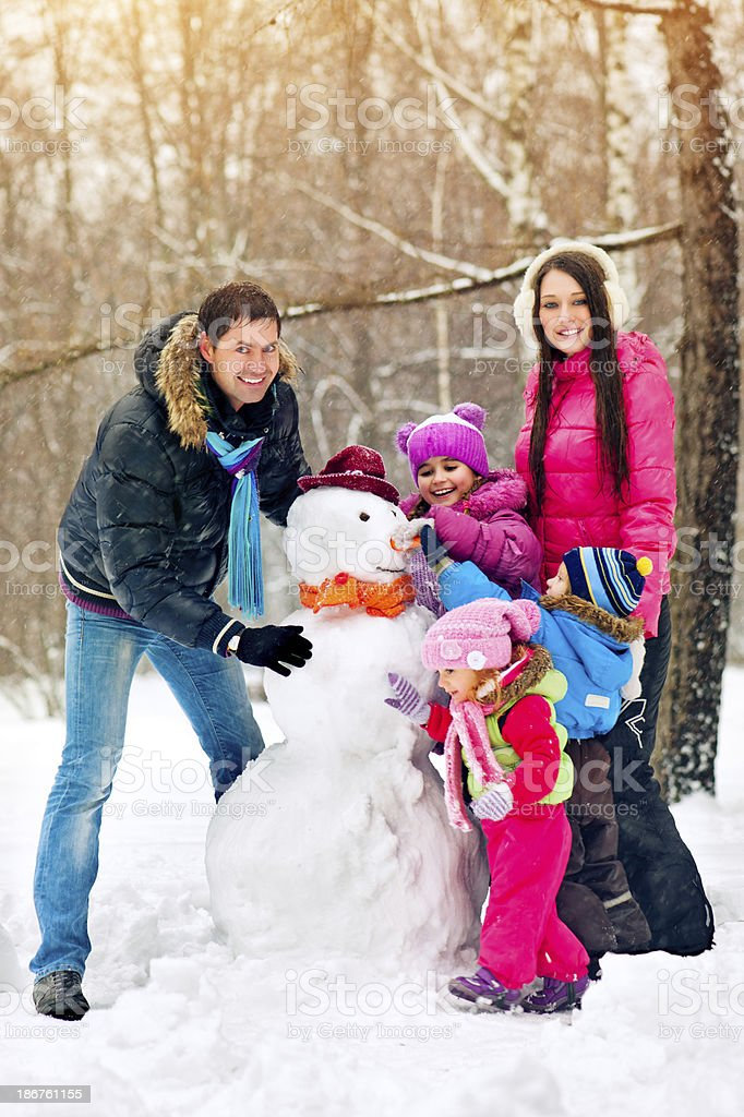 Family in a winter park royalty-free stock photo