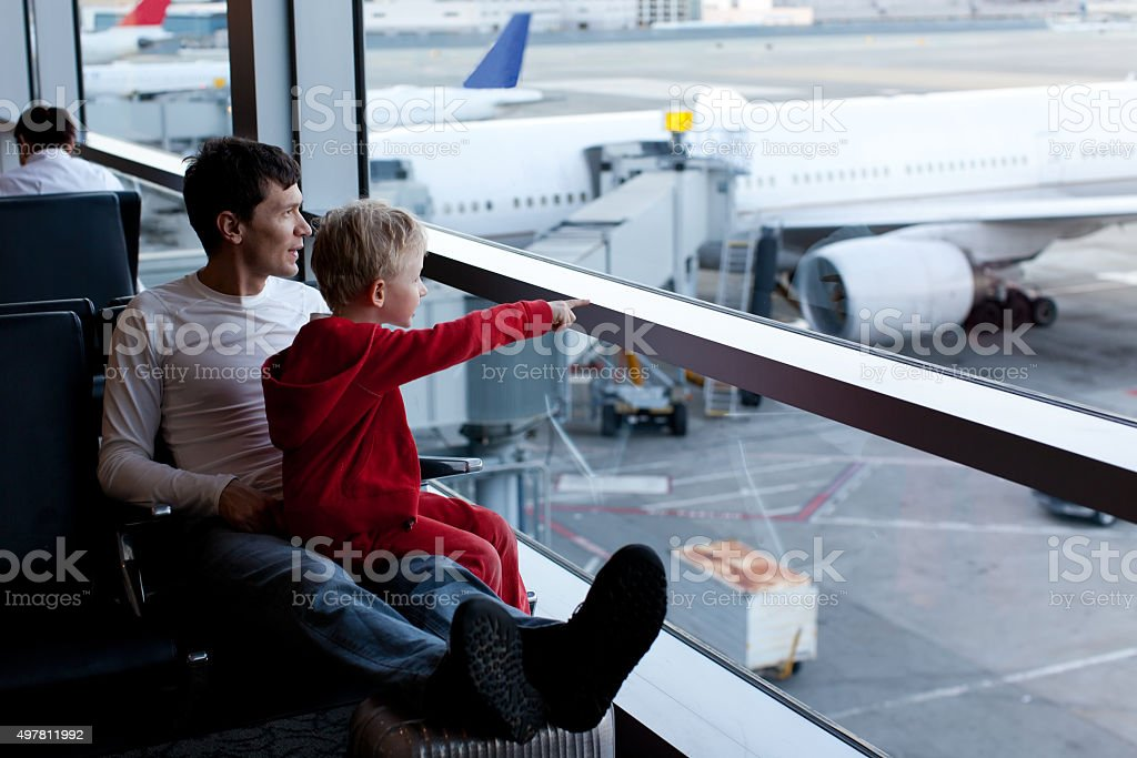 family in airport stock photo