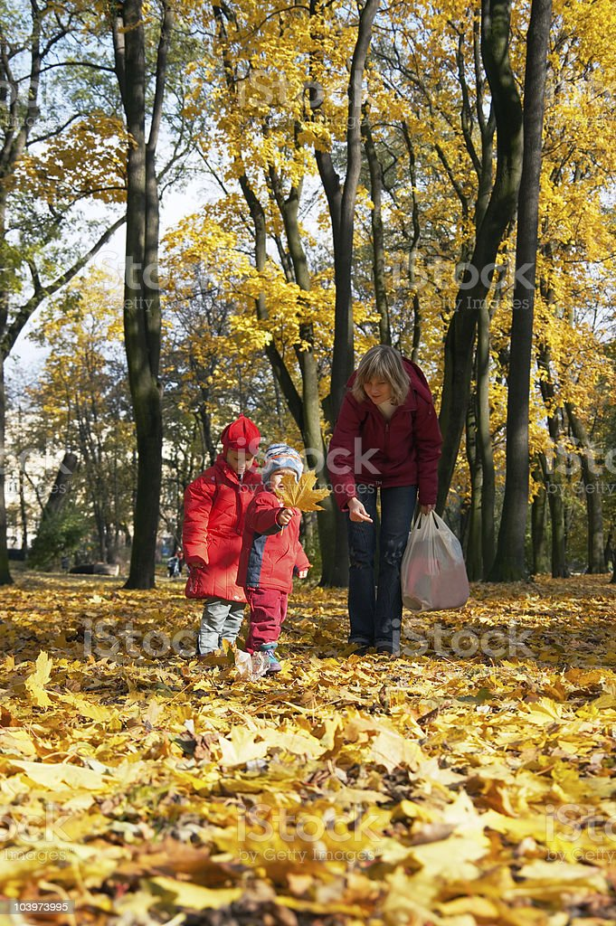 Family in autumn park royalty-free stock photo