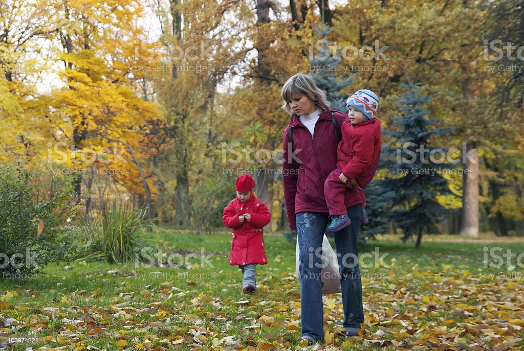 Family in autumn park royalty-free stock photo