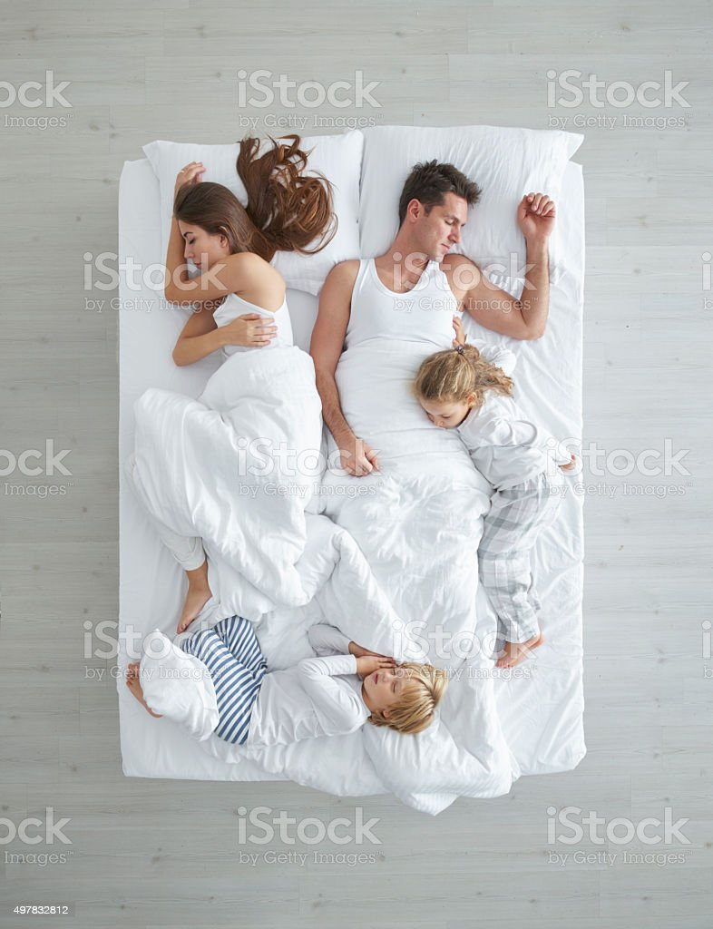 Nuclear Family In Bed stock photo