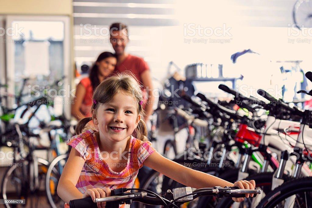 Family in bike store stock photo
