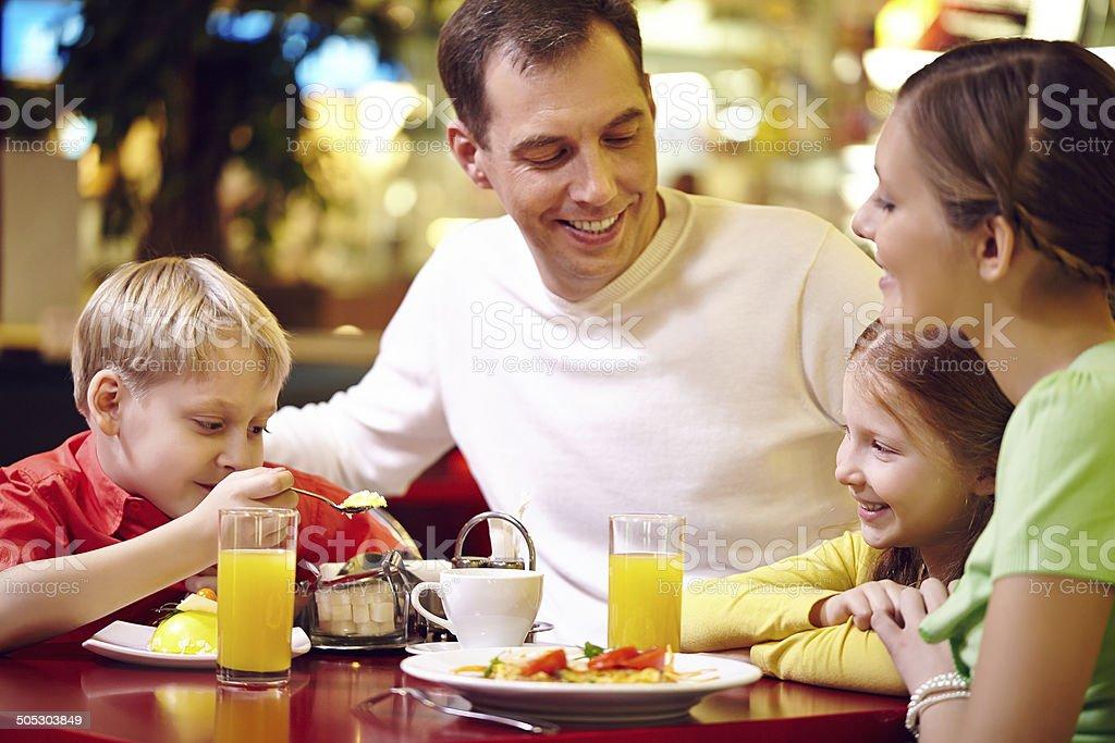Family in cafe stock photo