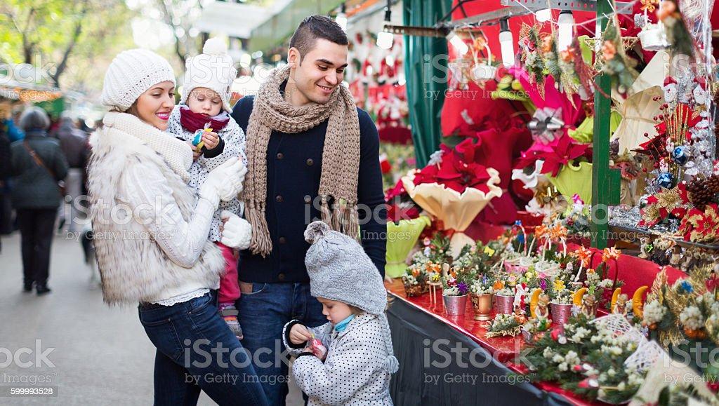 Family in Christmas fair stock photo