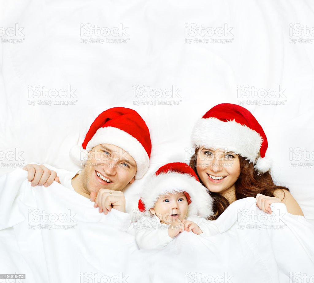 Family in Christmas Hat, Baby Kid Mother Father, White Background stock photo