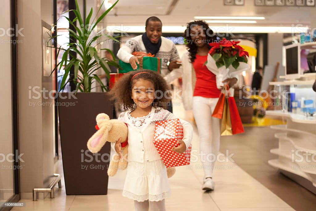 Happy family in Christmas shoppingwalking at shopping mall