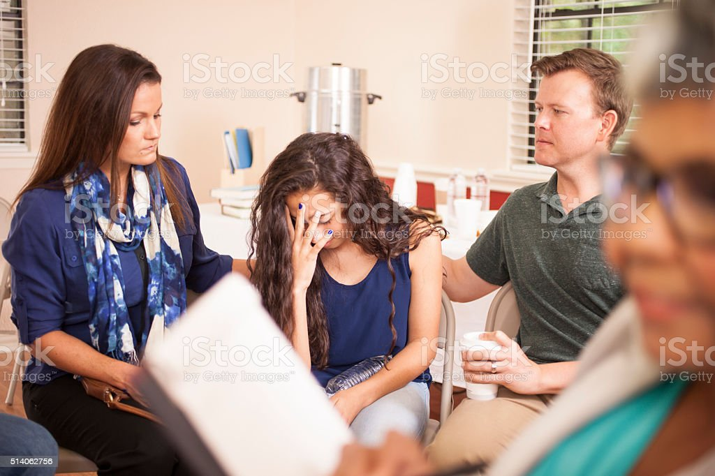 Family in counseling session with therapist. stock photo
