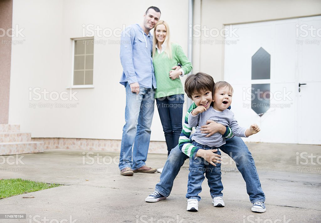 Family in front house royalty-free stock photo