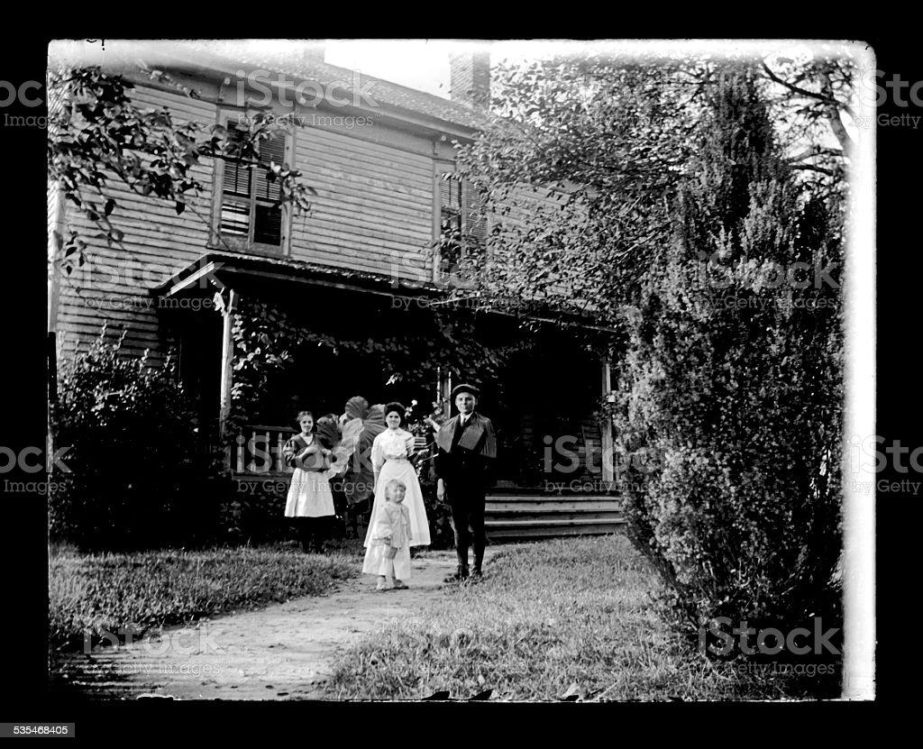 Family in Front of a Farmhouse, Circa 1890 stock photo
