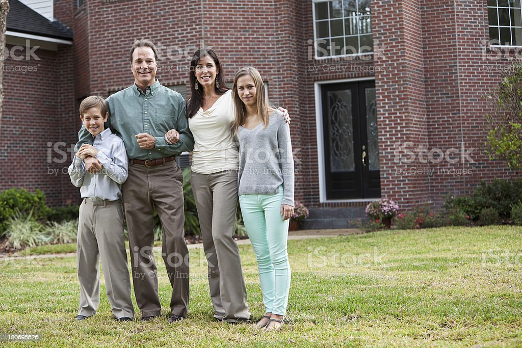 Family in front of home stock photo