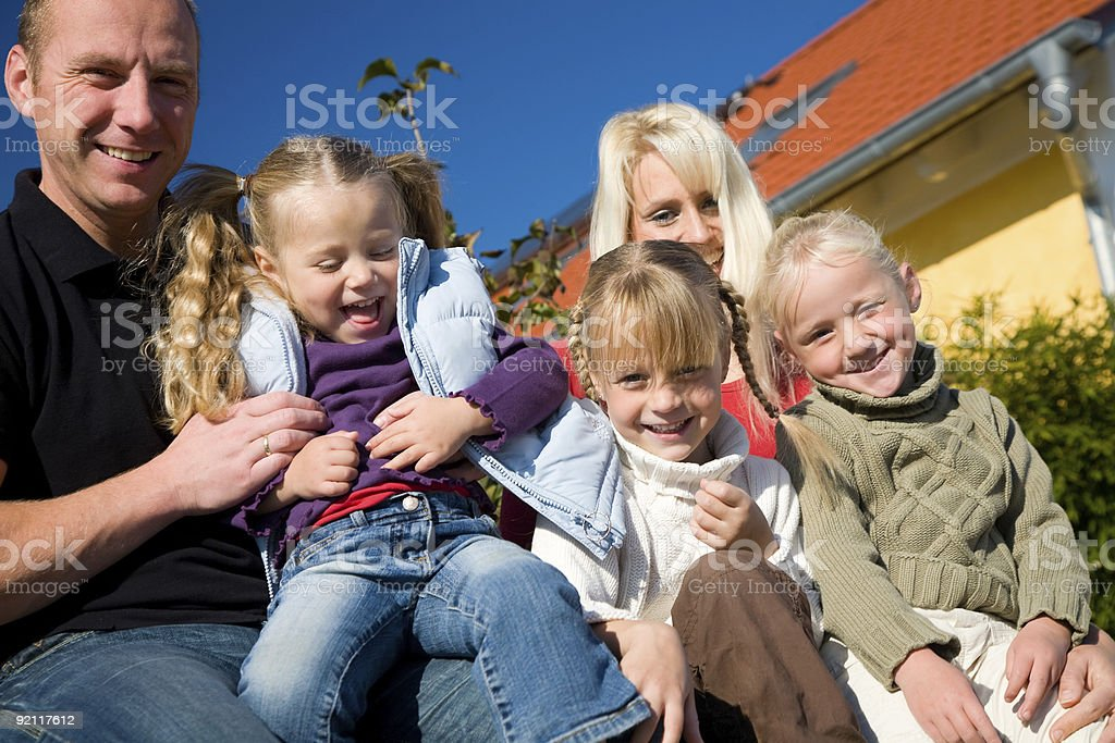 Family in front of home royalty-free stock photo
