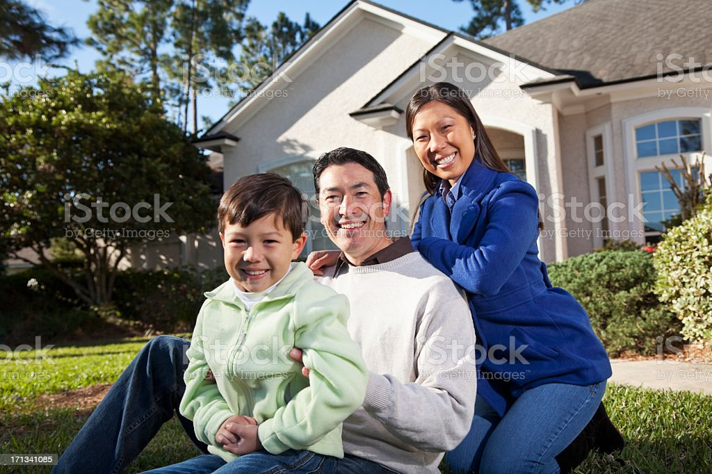 Family in front of house stock photo