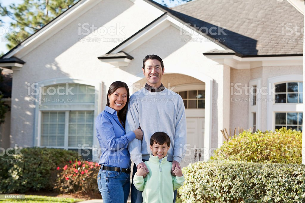 Family in front of house royalty-free stock photo