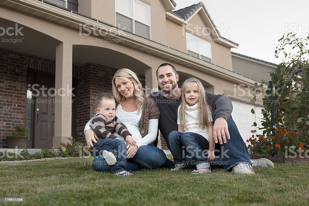 Family in front of their new house royalty-free stock photo