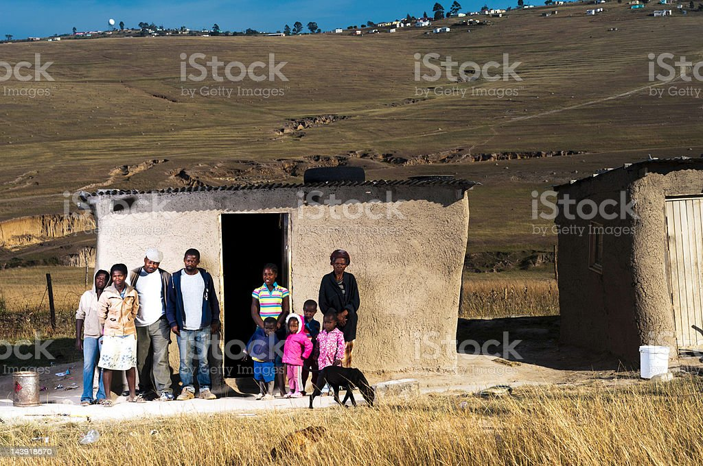 Family in front of there hut royalty-free stock photo