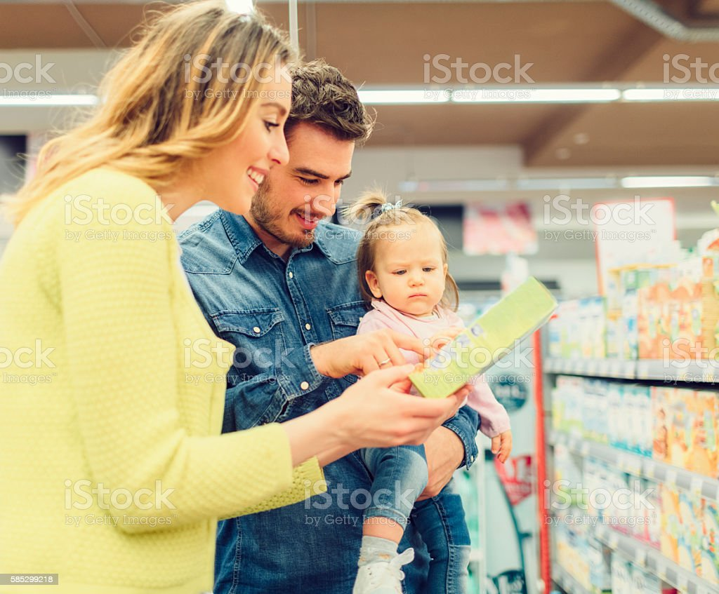 Family In Groceries Store stock photo