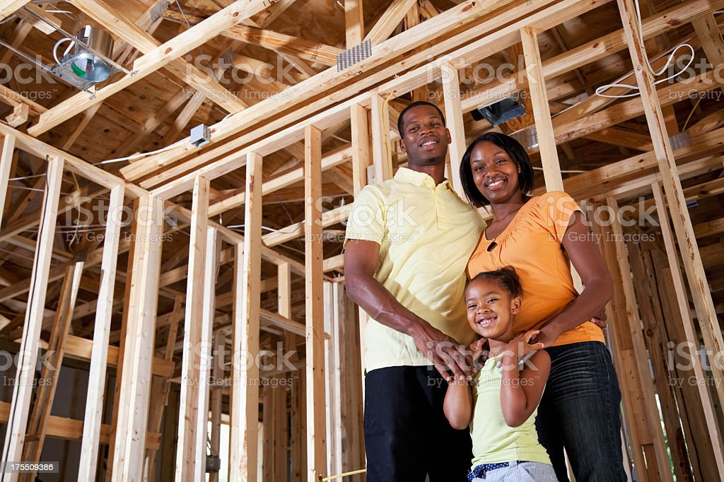 Family in house under construction royalty-free stock photo