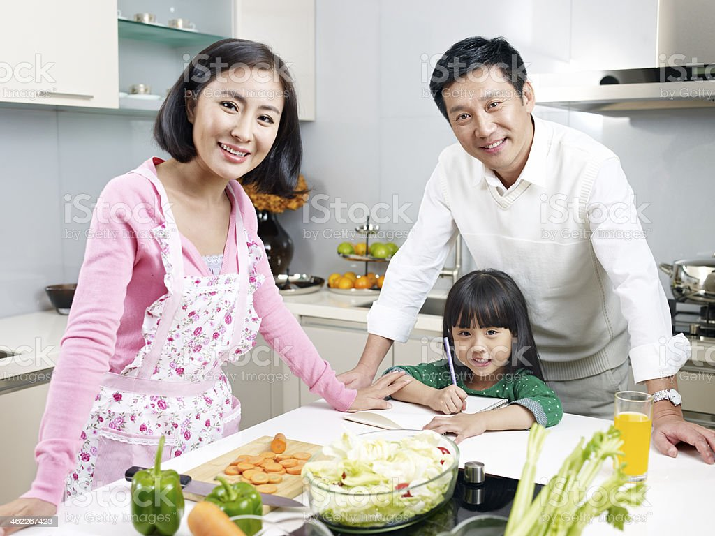 family in kitchen royalty-free stock photo