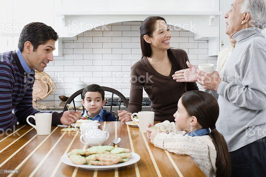 Family in kitchen stock photo