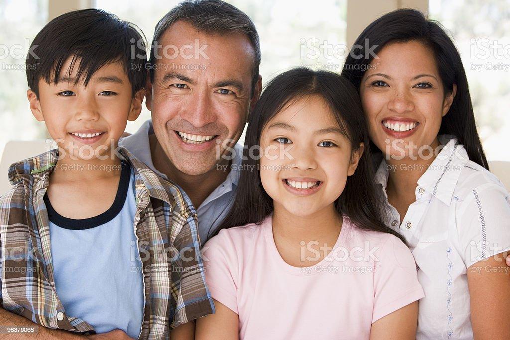 Family in living room stock photo