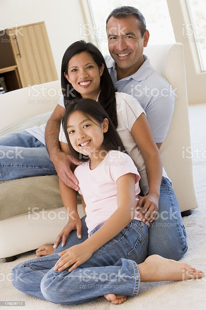 Family in living room smiling stock photo