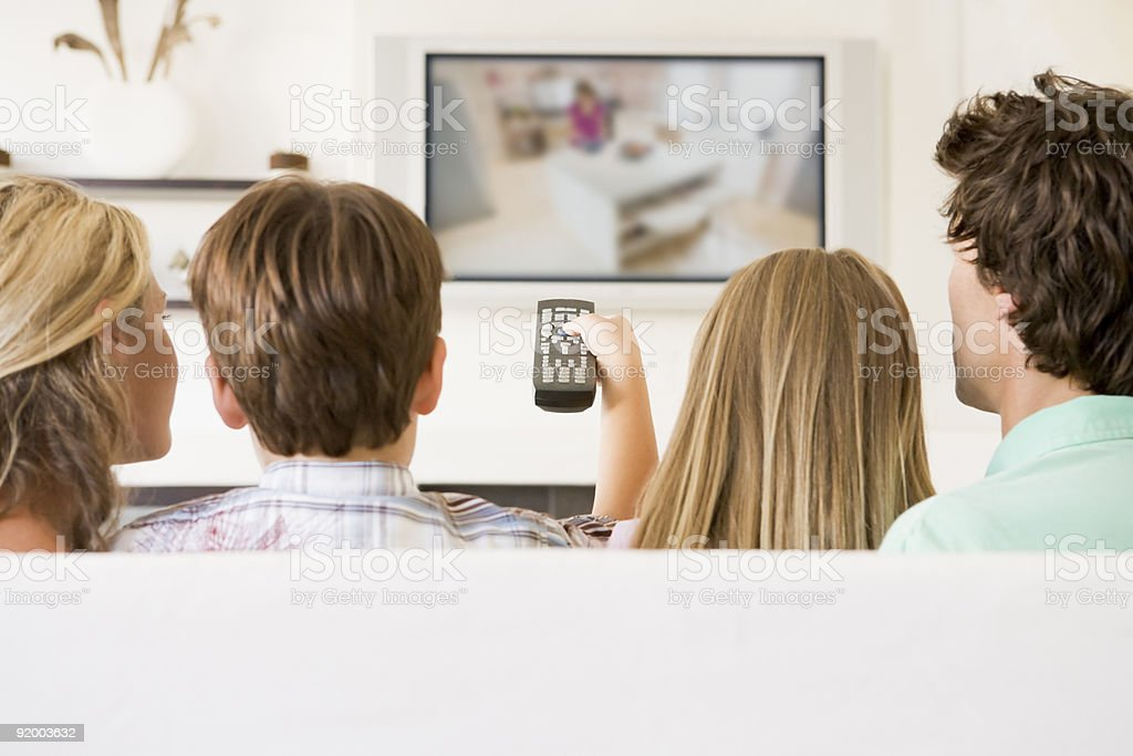 Family in living room watching TV stock photo
