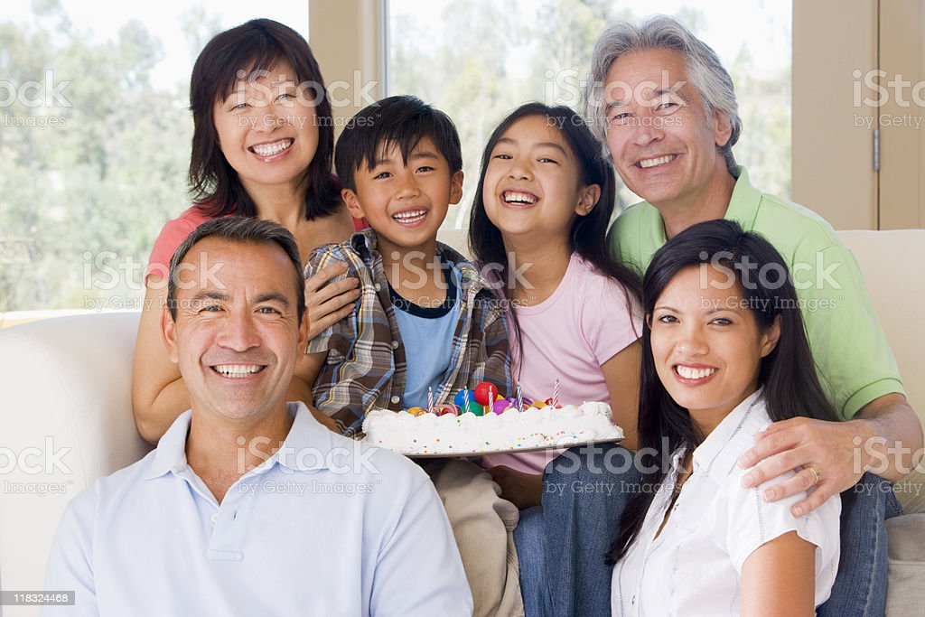 Family in living room with cake royalty-free stock photo