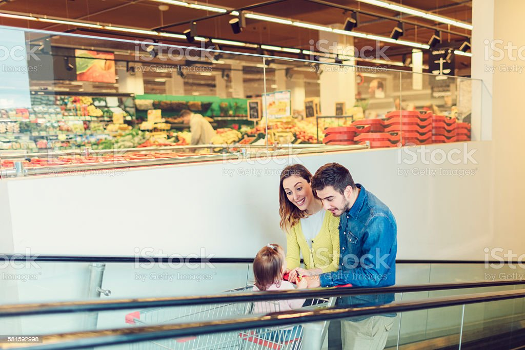 Family In Local Supermarket. stock photo
