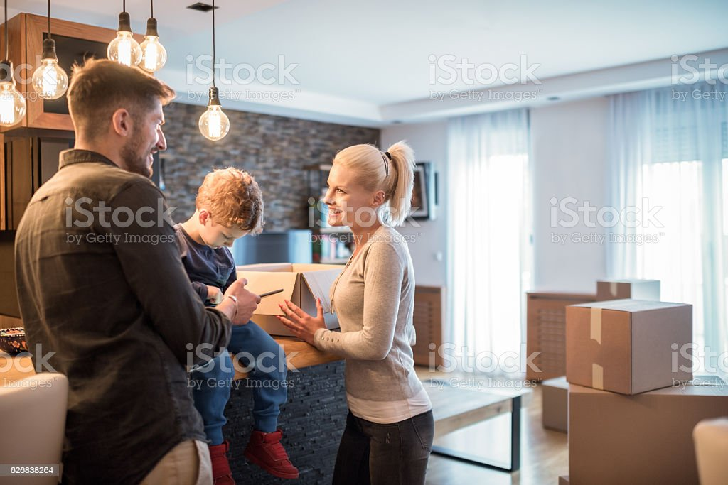 Family in new apartment stock photo