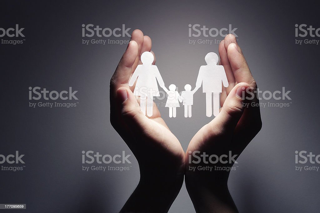 Family in palm concept royalty-free stock photo