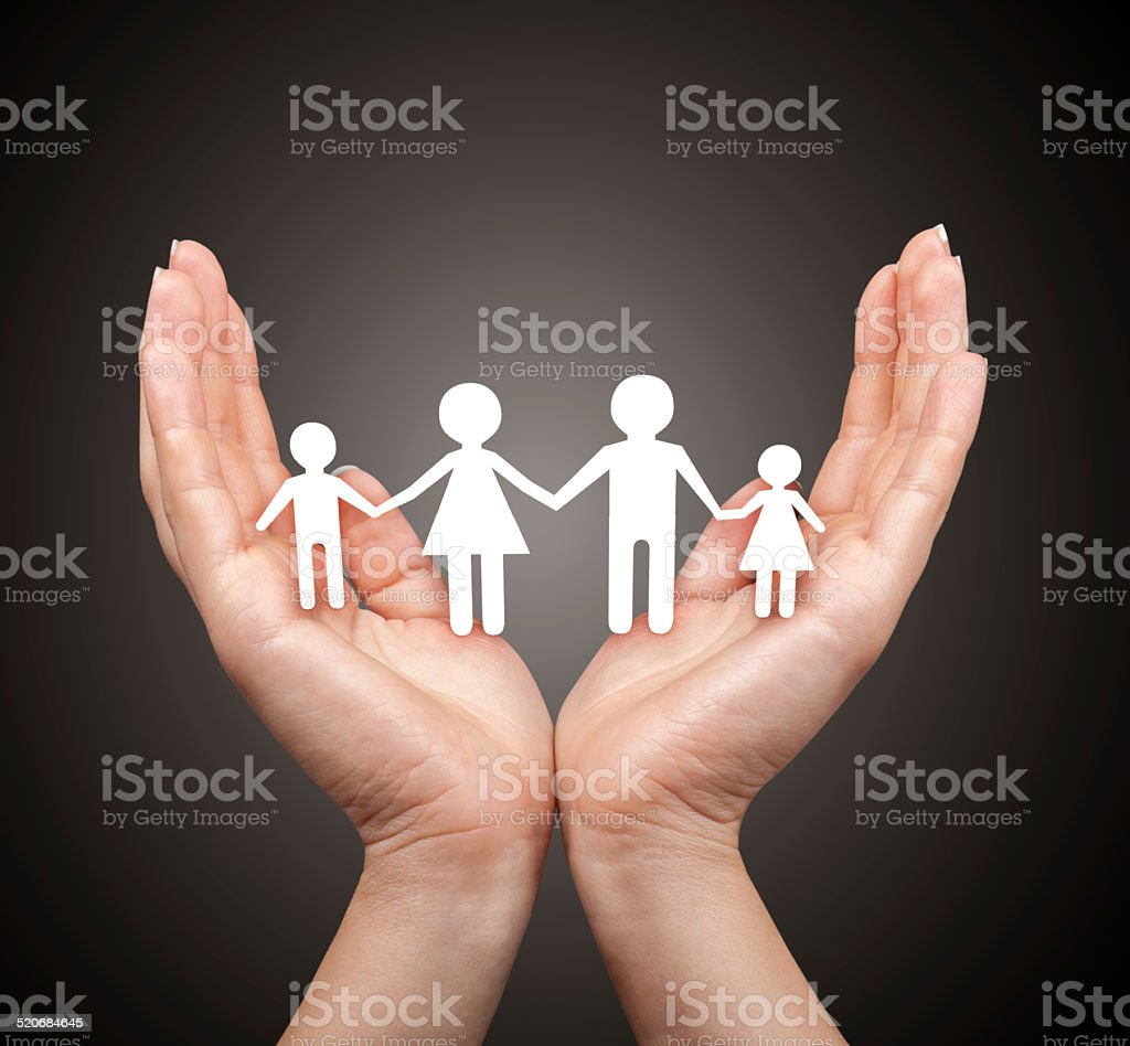 Family in palm concept stock photo