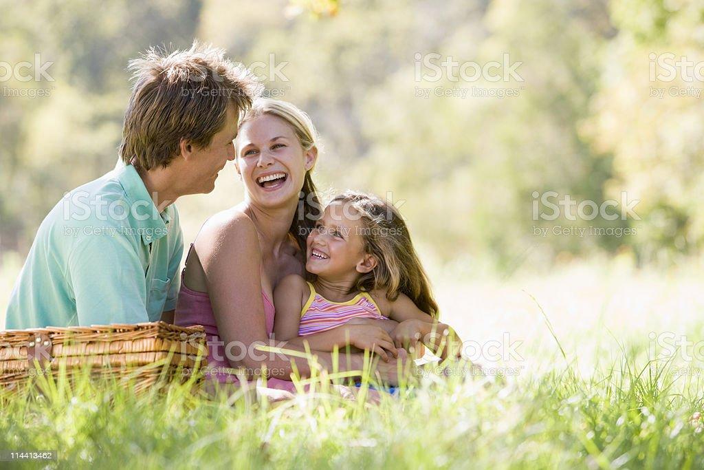Family in park having picnic stock photo