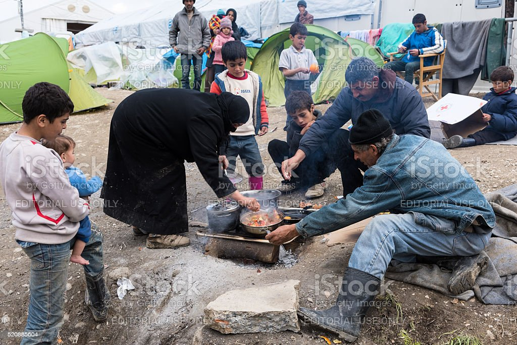 Family in refugees camp in Greece stock photo