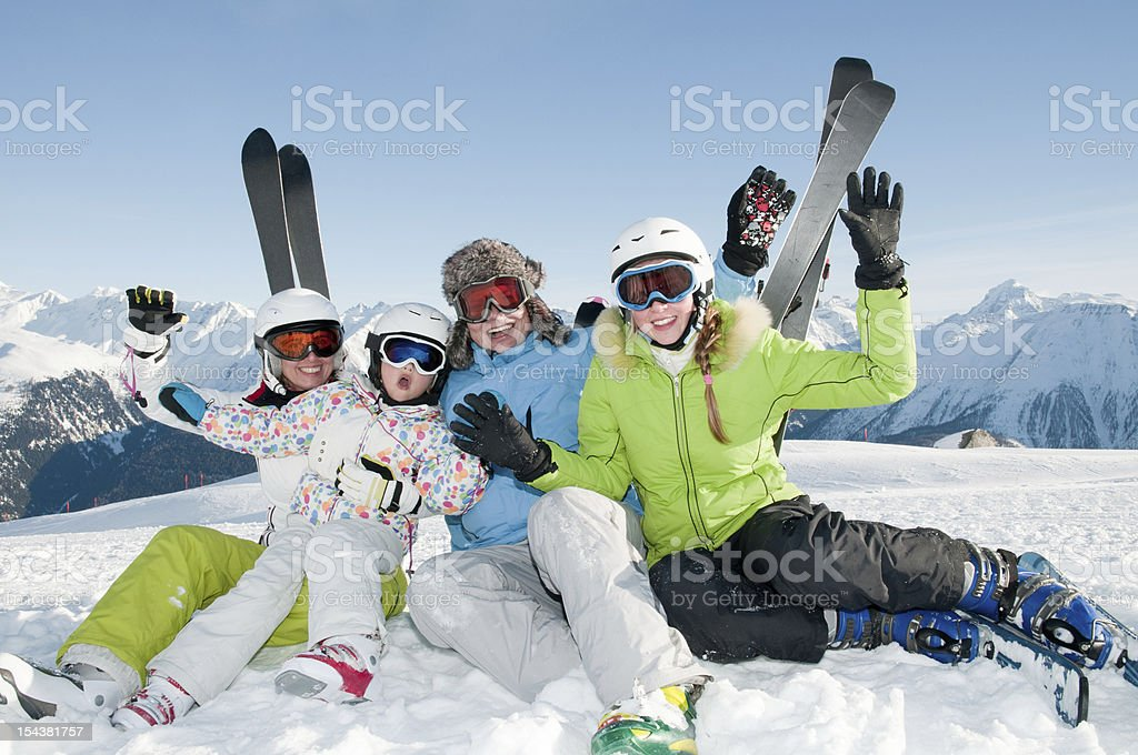 Family in ski gear on top of a mountain royalty-free stock photo