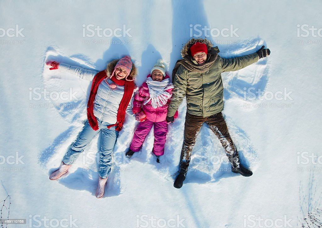 Family in snow stock photo