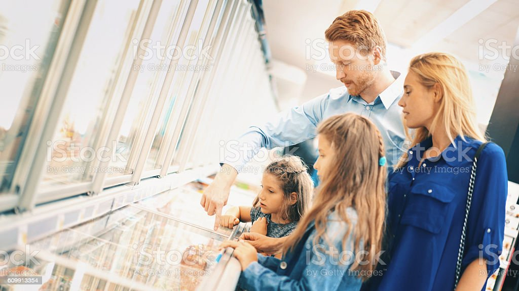 Family in supermarket. stock photo