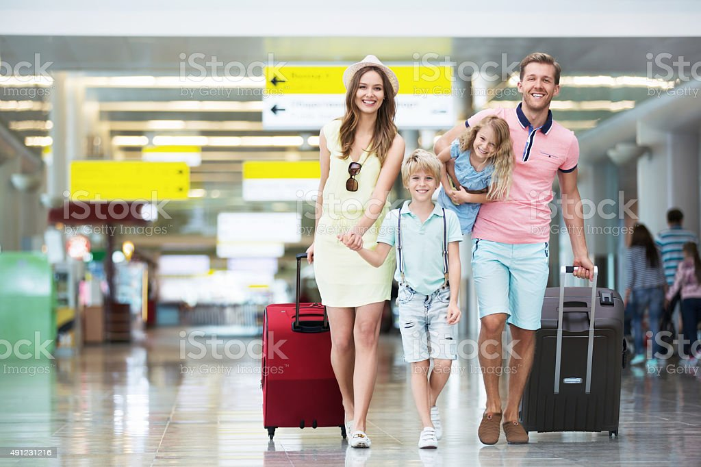 Family in the airport stock photo
