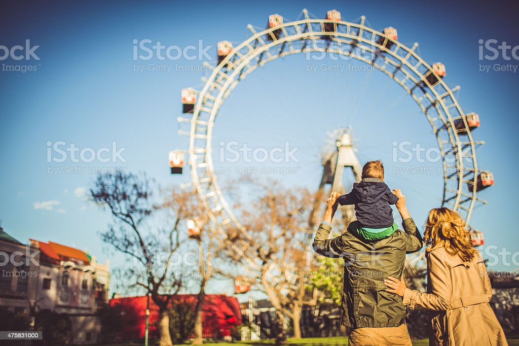 Family in the amusement park stock photo