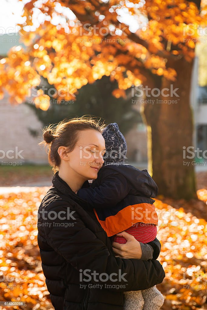 Family in the autumn park. stock photo