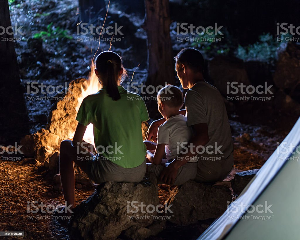 Family in the camping at night stock photo