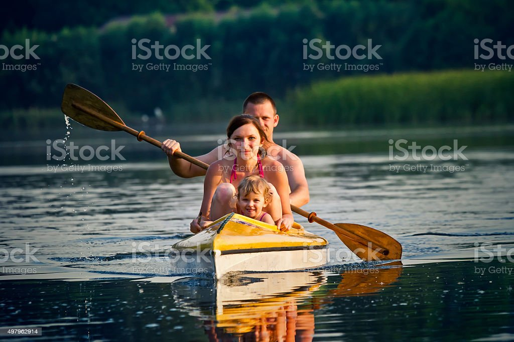 Family in the canoe stock photo