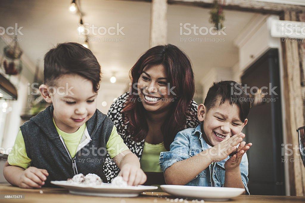Family in the kitchen baking stock photo