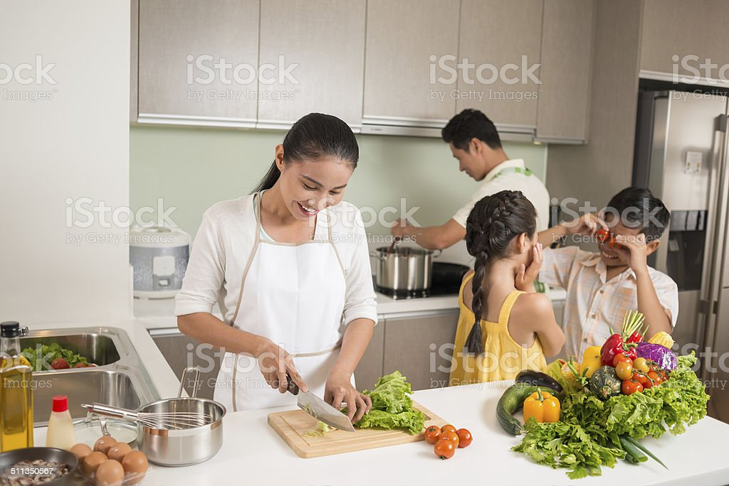 Family in the kitchen stock photo
