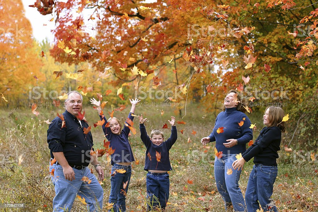 Family in the Leaves royalty-free stock photo