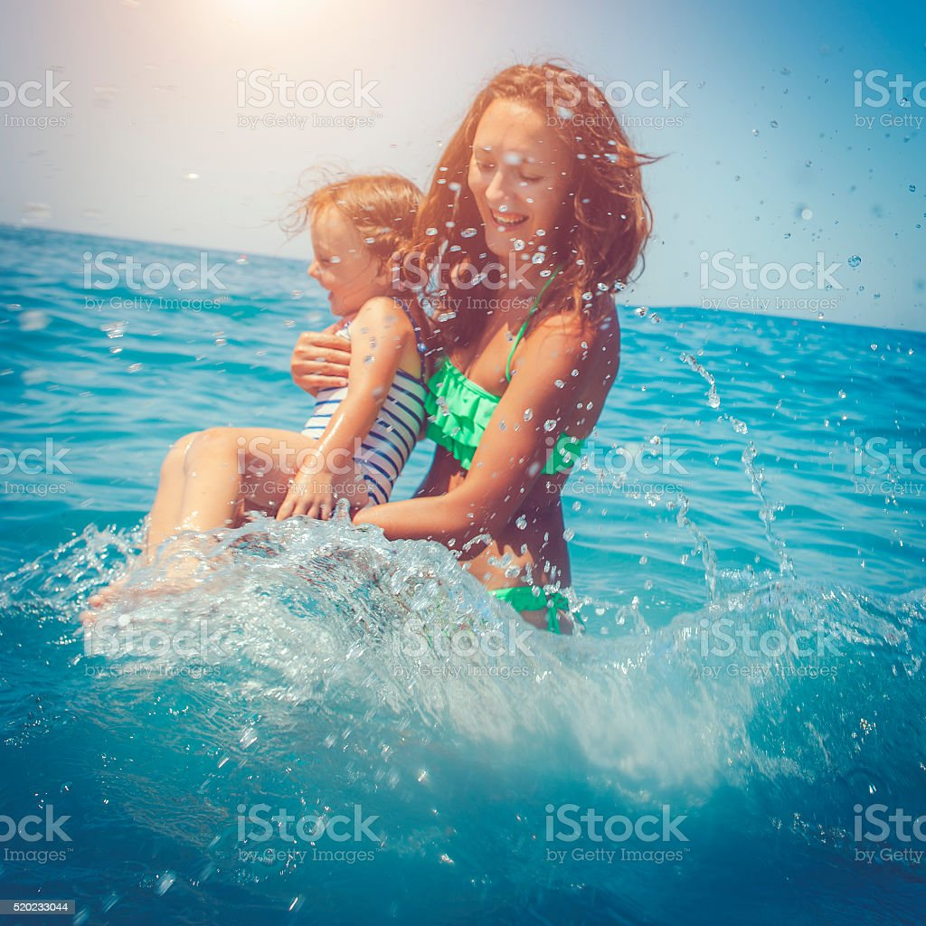 Family in the sea, focus on drops stock photo