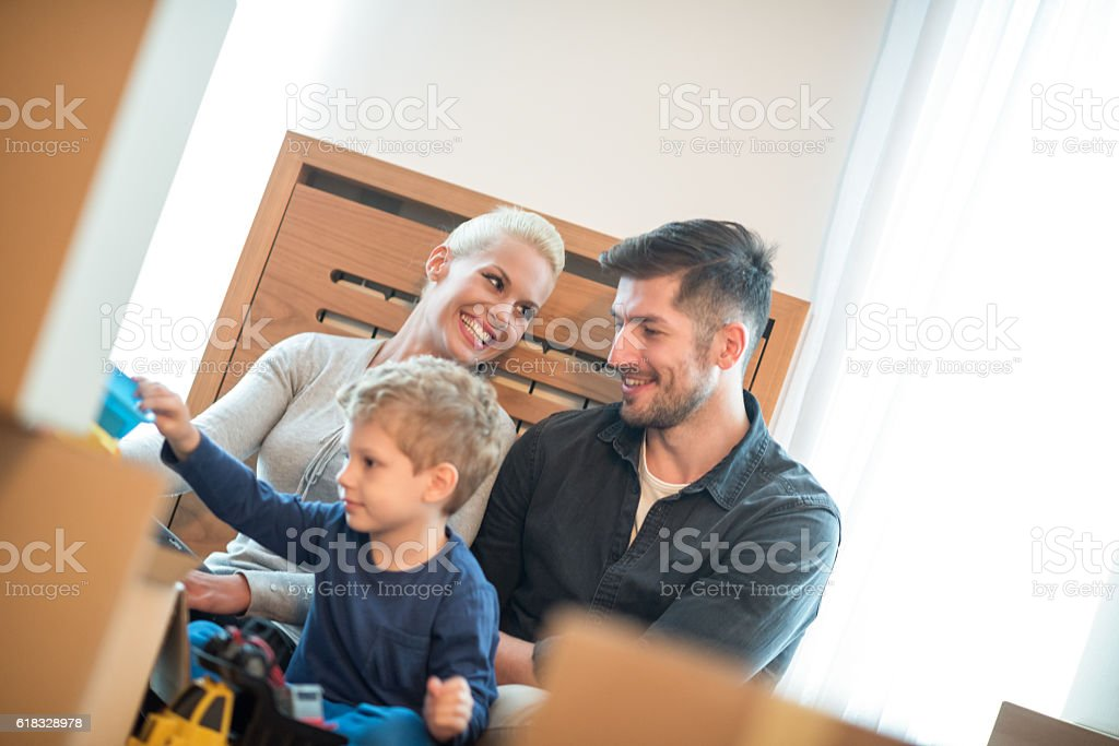 Family in their new apartment stock photo