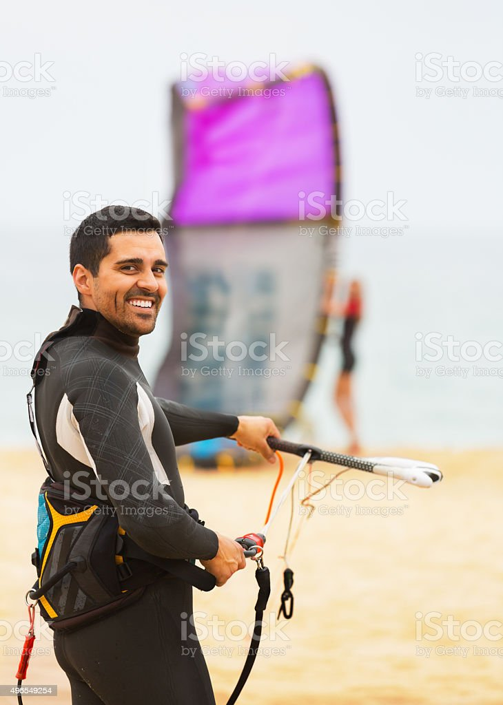 Family in wetsuits with surf boards stock photo