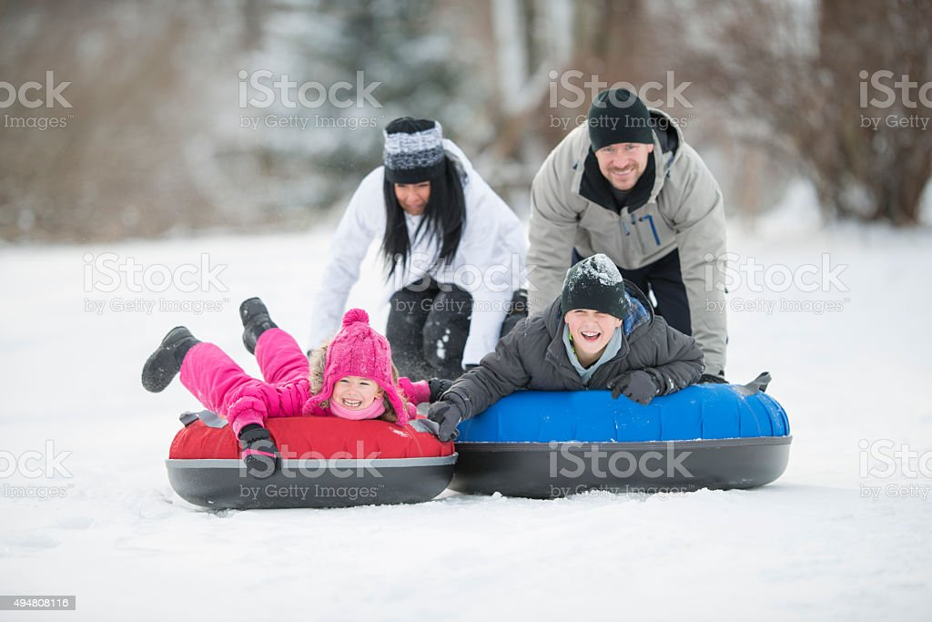 Family Inner Tubing on Vacation stock photo