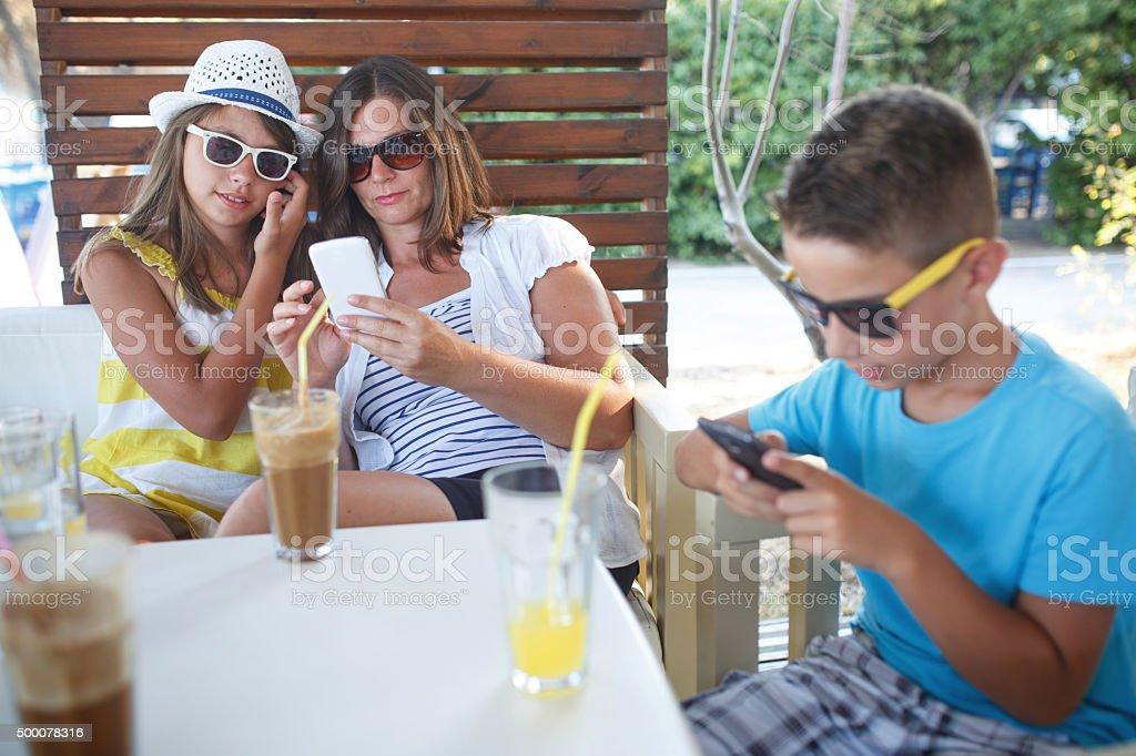 Family is occupied smartphones stock photo